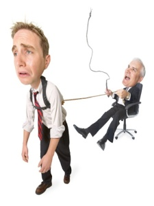 conceptual caricature of caucasian businessman in suit he whips employee pulling him around in chair