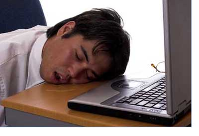 man asleep at the computer Dreamstime.com